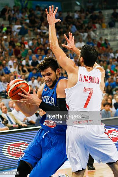 The tunisian guard Mourad El Mabrouk defends against a drive to the basket by The italian point guard Alessandro Gentile in the match between Italy...