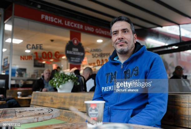 The Tunisian Jamel Chraie sits in a cafe in HamburgBarmbek Germany 29 July 2017 From here he and others stopped the knife attacker who previously...