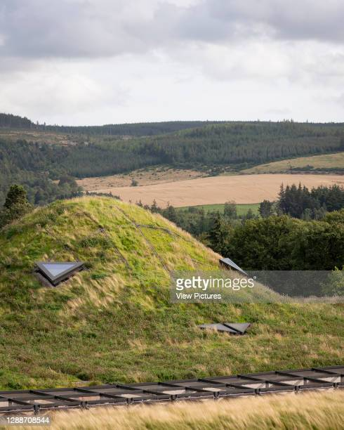 The turf roof in it's highland context. The Macallan Distillery and Visitor Experience, Aberlour, United Kingdom. Architect: Rogers Stirk Harbour +...