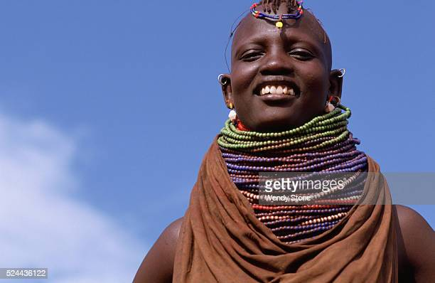 The Turkana a nomadic pastoral Nilotic people live in the Great Rift Valley in the northwestern comer of Kenya An apese wears her elaborately beaded...