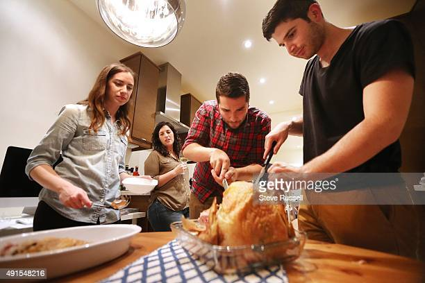 TORONTO ON OCTOBER 2 The turkey gets carved Toronto Star reporter Lauren Pelley hosts a Friendsgiving dinner Friendsgiving is growing popular among...
