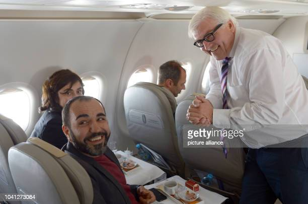 The turkish actor Adnan Maral German Foreign Minister FrankWalter Steinmeier and the artist and scholarship holder of the culture academy Tarabaya...
