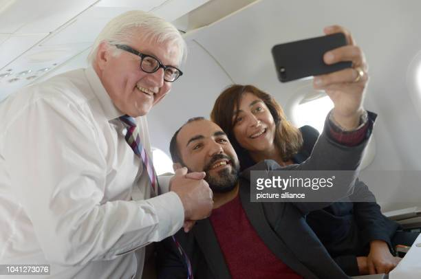 The turkish actor Adnan Maral takes a picture of himself German Foreign Minister FrankWalter Steinmeier and the artist and scholarship holder of the...