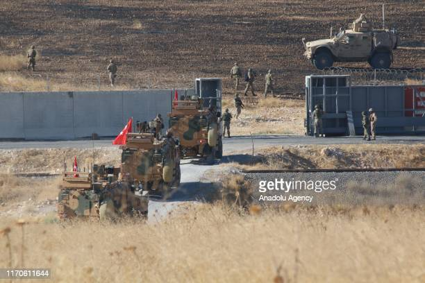 The Turkish and U.S. Troops start their second joint ground patrol within a planned safe zone in northern Syria along the Syrian-Turkish border, in...