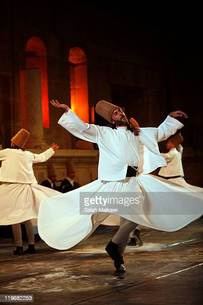 The turkish classical sufi band the Galata Mevlevi Ensemble perform at the northern amphitheatre during the Jerash Festival on July 23 2011 in Jerash...