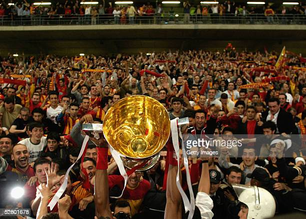 The Turkish Cup is held aloft by triumphant Galatasaray players after the final between Fenerbahce and Galatasaray in Ataturk Olympic Stadium May 11...
