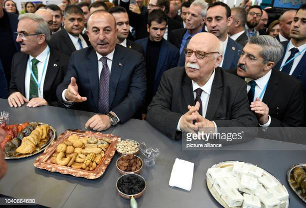 The Turkish foreign minister Mevlut Cavusoglu and the tourism minister Nabi Avci with traditional Turkish food at the ITB tourism trade show...