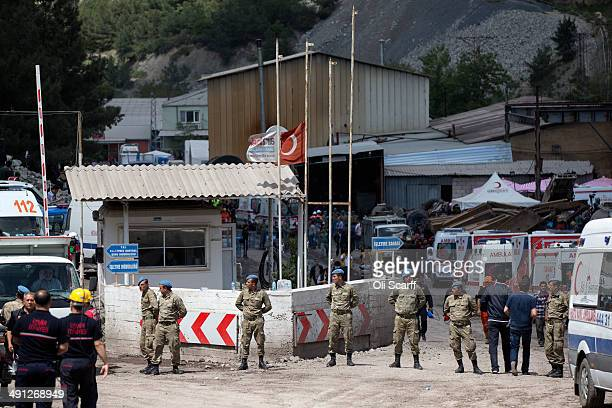 The Turkish national flag flies at half-mast near the entrance to the mine in Soma which collapsed on Tuesday killing at least 284 people on May 16,...