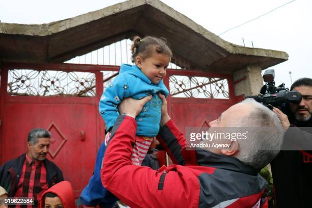 The Turkish Red Crescent's head Kerem Kinik holds a Syrian child in the village of Deir Ballut of Jinderes Afrin Syria which was cleared of PYD/PKK...