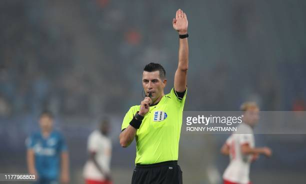 The Turkish referee Ali Palabiyik blows the whistle during the UEFA Champions League Group G football match between RB Leipzig and Zenit Petersburg...