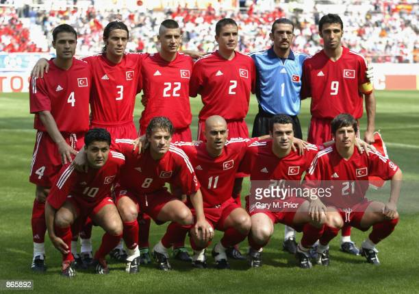 The Turkish soccer team pose for a team group before the first half during the Turkey v China Group C World Cup Group Stage match played at the Seoul...