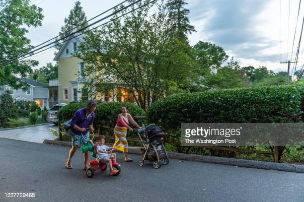 The Turner family heads home after a pool party at a friends houses in the Brookdale neighborhood in Bethesda MD on July 19 2020