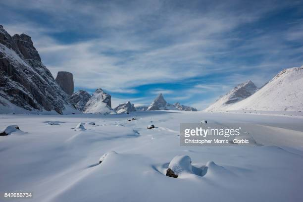 The Turner Glacier and Mountains, including Mt. Asgard , surround the frozen landscape of Akshayuk Pass, in Auyuittuq National Park on April 10, 2017...