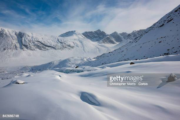 The Turner Glacier and Mountains surround the frozen landscape of Akshayuk Pass in Auyuittuq National Park on April 10 2017 on Baffin Island Canada