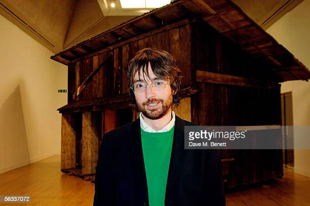 The Turner Prize winner of 2005 Simon Starling poses with his award winning project Shedboatshed at the Turner Prize 2005 at Tate Britain on December...