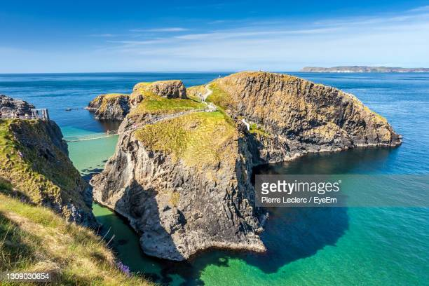 the turquoise water at carrick-a-rede rope bridge in northern ireland - ireland stock pictures, royalty-free photos & images