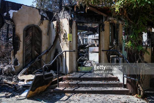 The Tuscan Village Winery is seen destroyed by the Clayton Fire in Lower Lake California August 16 2016 A man was arrested and charged with arson for...