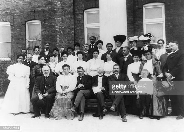 The Tuskegee Institute faculty with Andrew Carnegie Tuskegee Alabama 1906 LR seated in front row RC Ogden Mrs Booker T Washington Booker T Washington...