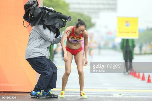 The TV Cameraman held Yin Hang of China after she finished the race as runnerup during Women's 50 kilometres Race Walk of IAAF World Race Walking...