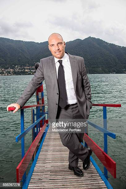 The TV host and media expert Andrea Pezzi wearing a man suit by Ferragamo and shoes by Fratelli Rossetti at the Forum Ambrosetti in Villa d'Este...