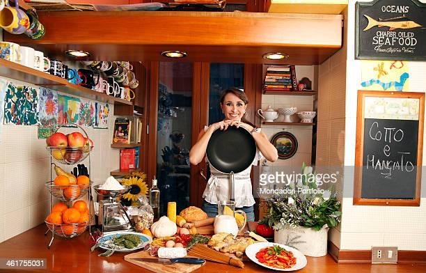 The TV host Benedetta Parodi during a photo shooting in her home kitchen in Milano Due where the TV show Cotto e Mangiato is shot Milan Italy 2010