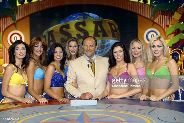 The Tv host Gerry Scotti posing in the studios of the TV quiz Passaparola with the letterine showgirls Alessia Mancini Benedetta Massola Daniela...