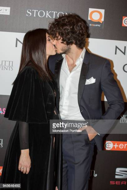 The TV personalities Francesca Rocco and Giovanni Masiero kissing each other at the charity gala Never Give Up at The Milan Westin Palace Milan Italy...