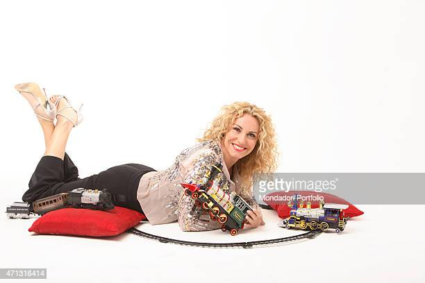 The TV presenter Antonella Clerici playing with a toy train during a photo shooting Rome Italy 11th December 2005