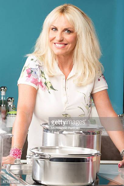The TV presenter Antonella Clerici posing smiling behind the stove for a photo shooting in the studios of the TV show La prova del cuoco Rome Italy...