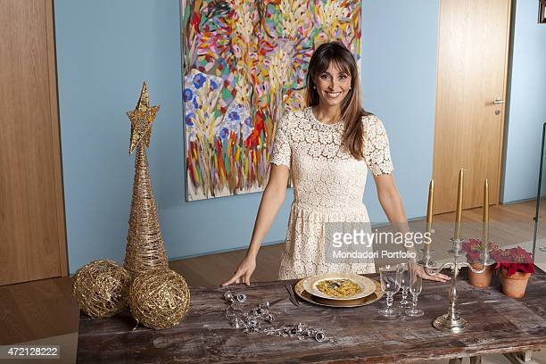 """The TV presenter Benedetta Parodi posing for the photo shooting dedicated to the great chefs. On the table, the dish she proposed for Christmas...."