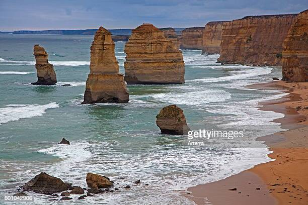 The Twelve Apostles group of eroded limestone sea stacks off the shore of the Port Campbell National Park along the Great Ocean Road in Victoria...