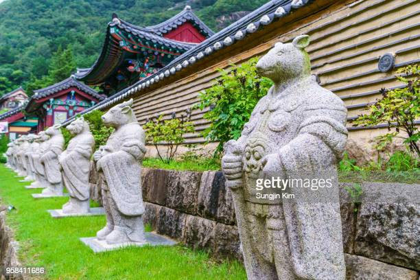 the twelve zodiac animal deities at the buddhist temple - gangwon province stock pictures, royalty-free photos & images