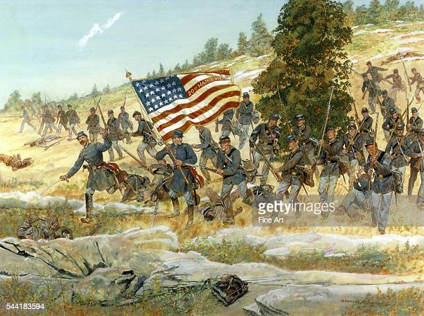 The Twentieth Maine regiment of the Union army charging with their flag in the lead at the Battle of Gettysburg Pennsylvania July 2 1863 Oil and...