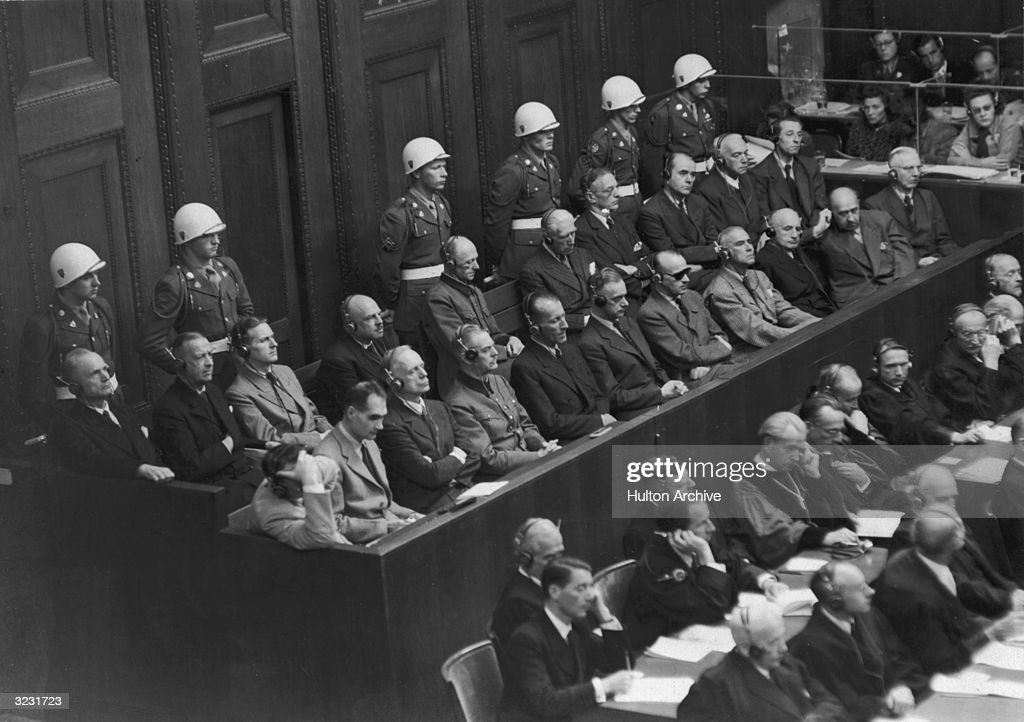 The twenty-one defendants at the Nuremberg War Crimes Trial sitting in the dock awaiting sentencing, Nuremberg, Germany. Among the defendants are, (front row; L-R): Hermann Goering (1893-1946), who received the death penalty; Rudolf Hess (1894-1987), life imprisonment; and Joachim von Ribbentrop (1893-1946), death, October 1946.