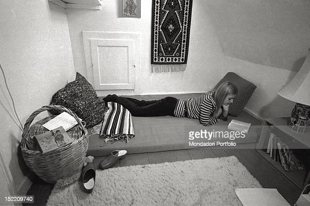 The twentyoneyearold Annelise Olsen is reading a book on a mattress in her private bedroom in 'Felicia' the commune of Copenhagen where four couples...