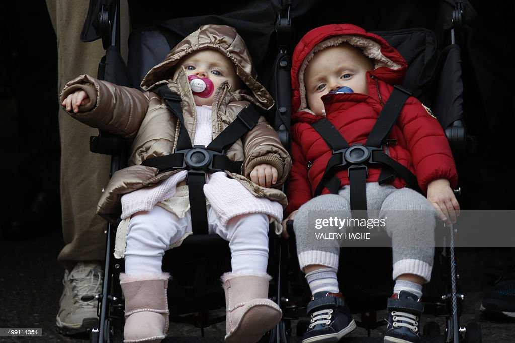 The twin children of the Prince and Princess of Monaco, Prince Jacques (R) and Princess Gabriella, are pictured as their parents take part in a 'March for climate' on November 29, 2015 in Monaco, within the start of the UN conference on climate change COP21 that takes place in Paris. Some 150 leaders including will attend the start on November 30 of the UN conference, tasked with reaching the first truly universal climate pact. / AFP / VALERY