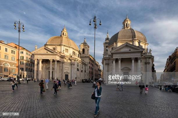 the twin churches with people walking in the foreground at piazza del popolo,rome. - emreturanphoto stock pictures, royalty-free photos & images