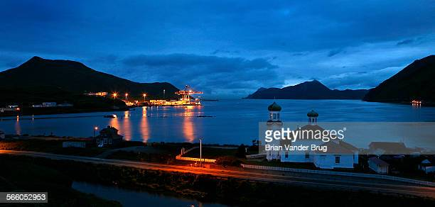 The twin domes of the Russian Orthodox Church in an early morning view from Unalaska on Unalaska Island toward Dutch Harbor Dutch Harbor is at the...