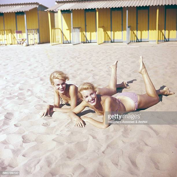 The twin sisters and famous German variety showgirls Alice and Ellen Kessler smiling at the beach They knew the celebrity during the 1960s and became...