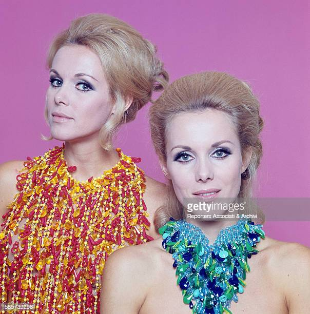 The twin sisters and famous German variety showgirls Alice and Ellen Kessler posing in a studio They knew the celebrity during the 1960s and became...