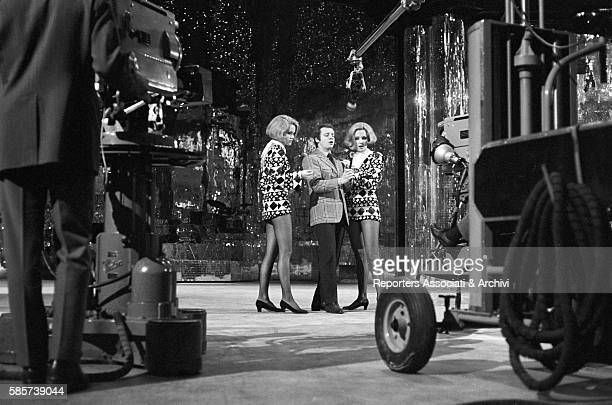 The twin sisters and wellknown German variety showgirls Alice and Ellen Kessler shooting the TV show 'Canzonissima' They became two Italian TV...