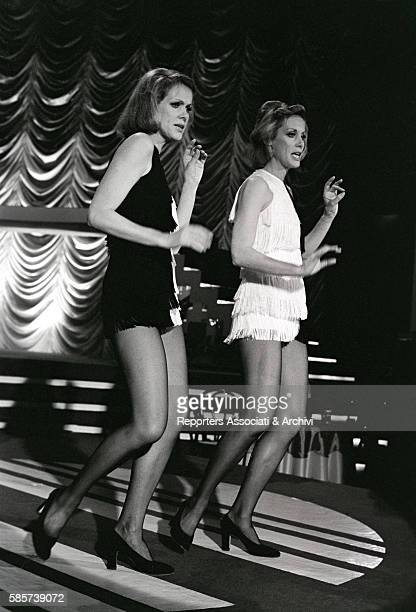 The twin sisters and wellknown German variety showgirls Alice and Ellen Kessler dancing in the TV show 'Punto e basta' The two dancers became two...