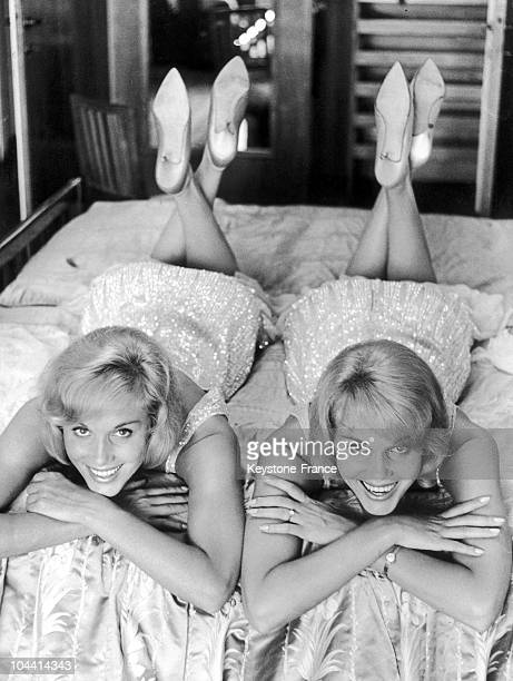 The twin sisters Ellen and Alice KESSLER dancers at the Lido lying on a bed in Venice during the International Film Festival on August 22 1961
