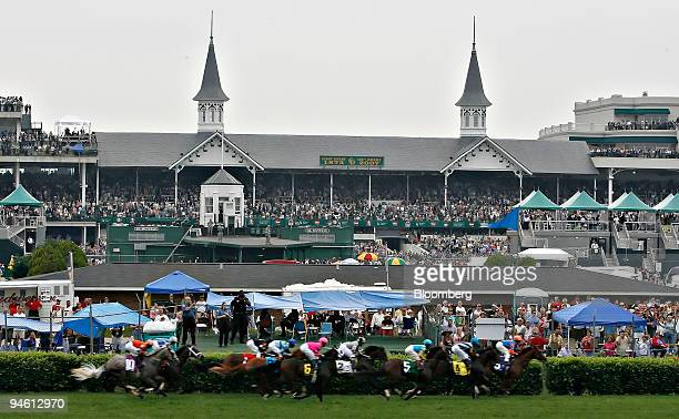 The twin spires of Churchill Downs rise in the background of a race being run on the inside turf track Friday May 4 in Louisville Kentucky
