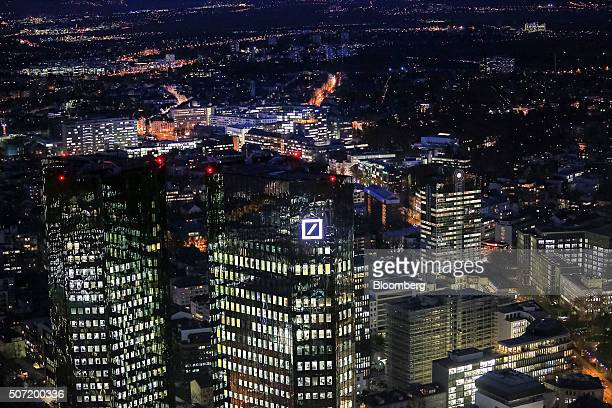 The twin tower headquarter offices of Deutsche Bank AG left stand illuminated at night in Frankfurt Germany on Wednesday Jan 27 2016 German domestic...