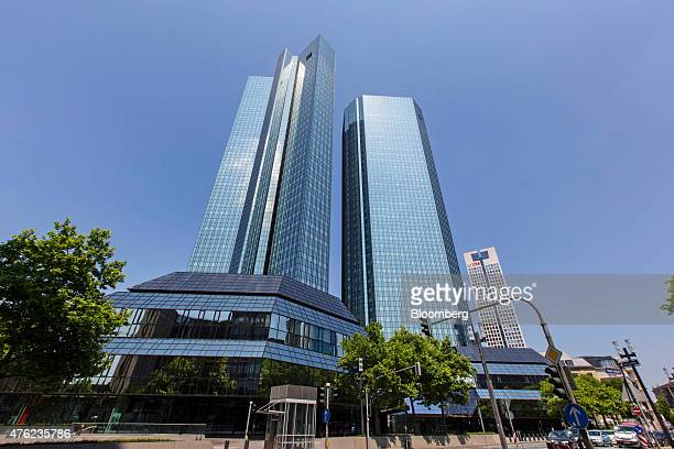 The twin tower skyscraper headquarters of Deutsche Bank AG stand beside a park in Frankfurt Germany on Saturday June 6 2015 Deutsche Bank AG is...