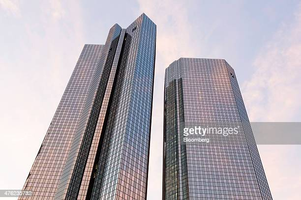The twin tower skyscraper headquarters of Deutsche Bank AG stand at sunset in Frankfurt Germany on Saturday June 6 2015 Deutsche Bank AG is...