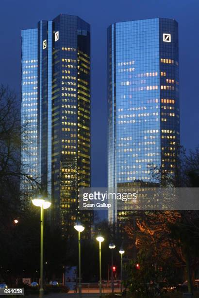 The twin towers of the Deutsche Bank headquarters are seen in twilight January 22 2002 in Frankfurt Germany Deutsche Bank is Germanys biggest...