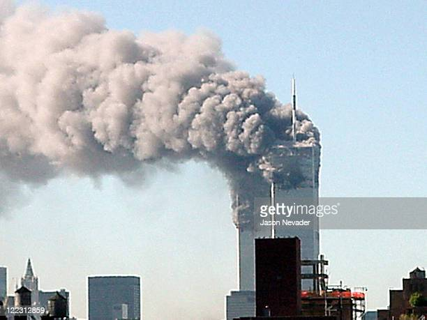 The twin towers of the World Trade Center are shown after hijacked planes were crashed into them