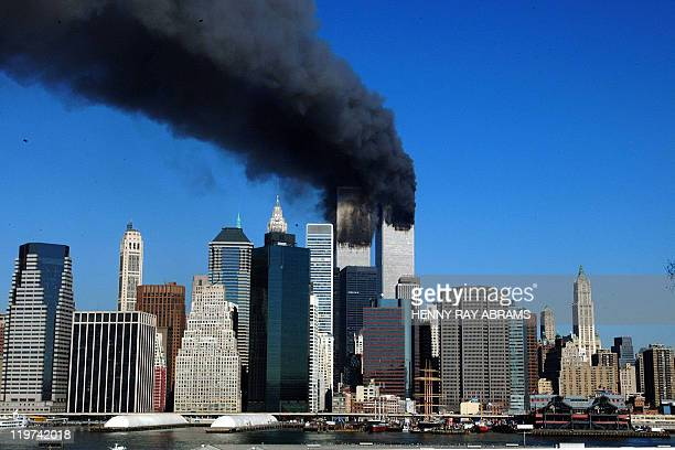 The twin towers of the World Trade Center billow smoke after hijacked airliners crashed into them early 11 September, 2001. The suspected terrorist...